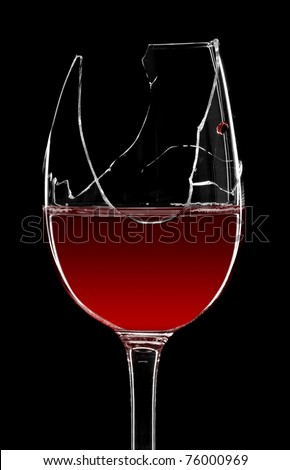 Broken glass of red wine isolated on black - stock photo
