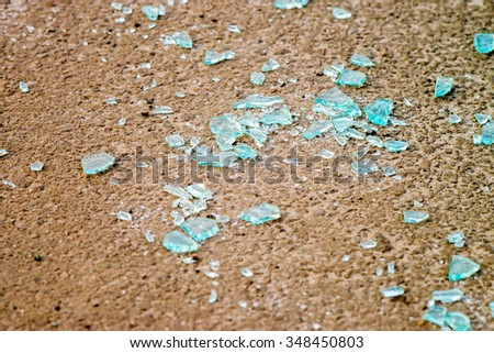 broken glass on the asphalt - stock photo