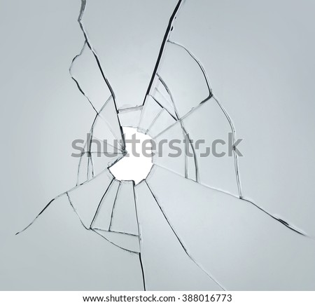 broken glass on white background with hole - stock photo
