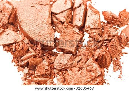 Broken gold eye shadow, isolated on white macro - stock photo