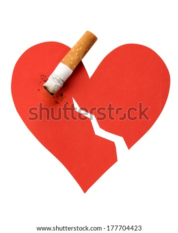 Broken heart and cigarette butt on a white background - stock photo