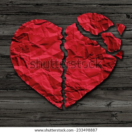 Broken heart breakup concept as a separation and divorce icon as red crumpled paper shaped as a torn love on old wood also a symbol of medical cardiovascular health care problems due to illness. - stock photo