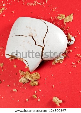 Broken heart honey cookie  on red background - stock photo