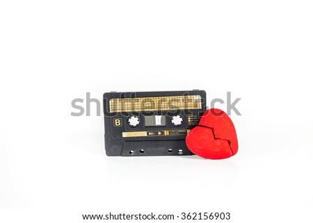 Broken heart with cassette tape,The concept feeling love. - stock photo