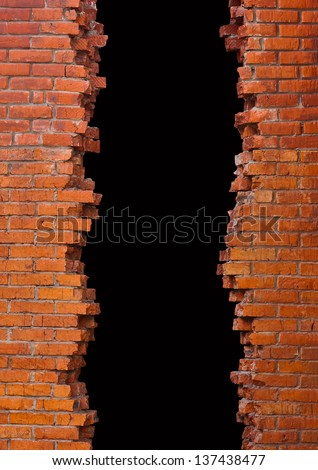 Broken into a brick wall with a black field - stock photo