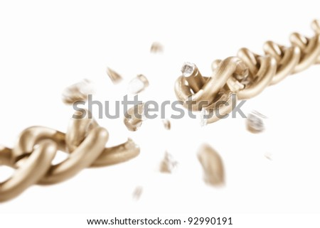 Broken link of golden chain with blurry movement of the scattered pieces, isolated against white background. small depth of field - stock photo