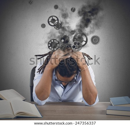 Broken man and tired from much study - stock photo