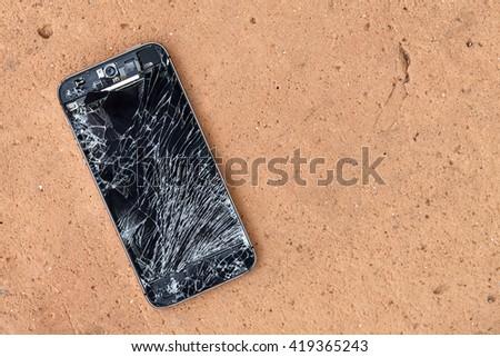 Broken mobile phone - stock photo