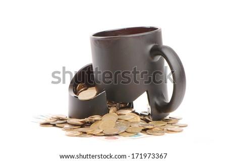 Broken mug and coins  - stock photo