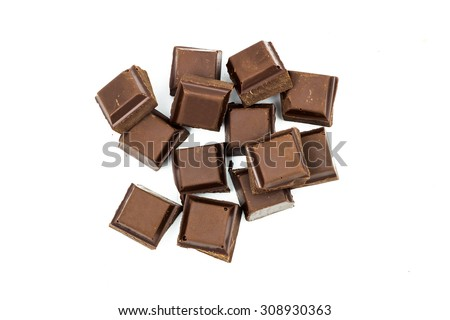 Broken, natural black chocolate bar isolated on white background, top view - stock photo