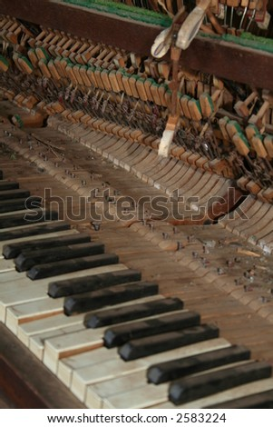 broken old piano full of dust - stock photo