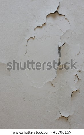 broken old wall with plaster missing - stock photo