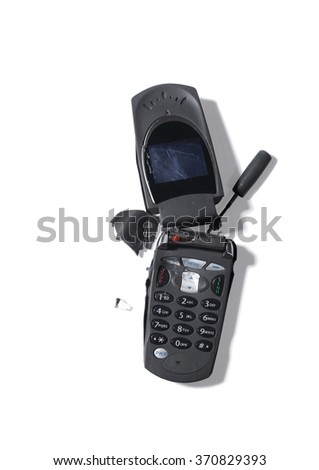 Broken outdated mobile telephone - stock photo