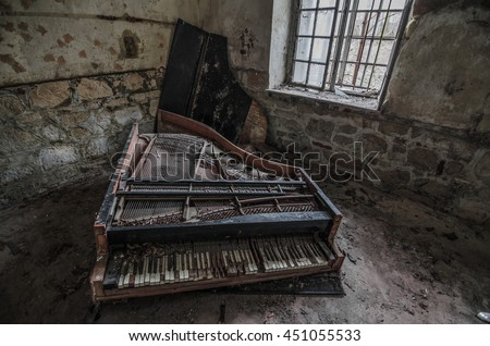 broken piano in an abandoned room - stock photo