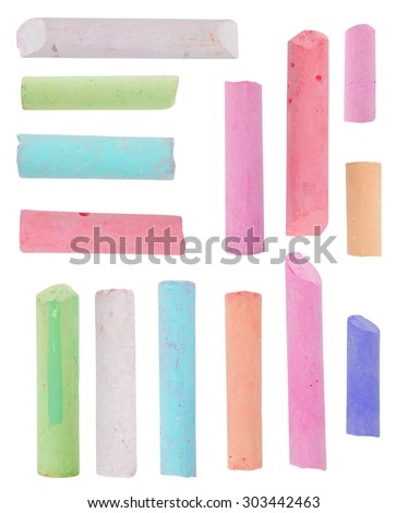 broken pieces of colored chalk isolated on white background - stock photo