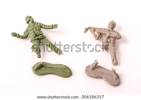 Broken Plastic Toy Soldiers on white background - stock photo