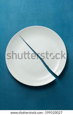 Broken Porcelain Plate - stock photo