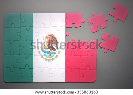 broken puzzle with the national flag of mexico on a gray background - stock photo