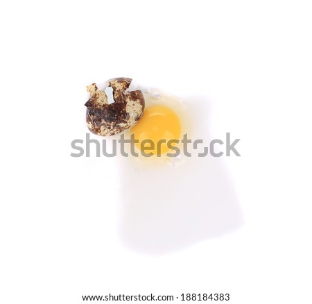 Broken quail egg. Isolated on a white background. - stock photo