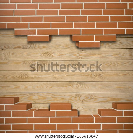 Broken red brickwall with wood boards in the background - stock photo
