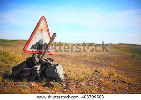 Broken rough road sign - stock photo