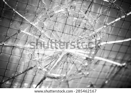 Broken safety glass texture, black and white image - stock photo