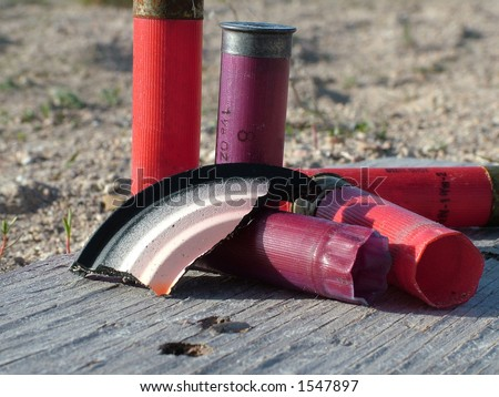 Broken shooting clay and expended shells. - stock photo
