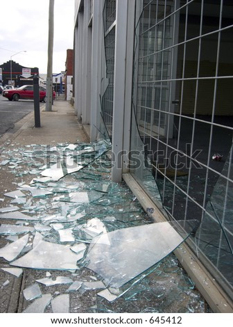Broken shop window with security screen. - stock photo