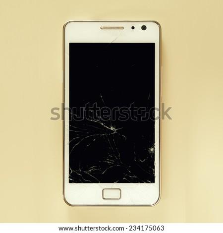 Broken smartphone screen - stock photo