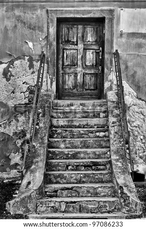 broken stairs at the entrance to the house - stock photo