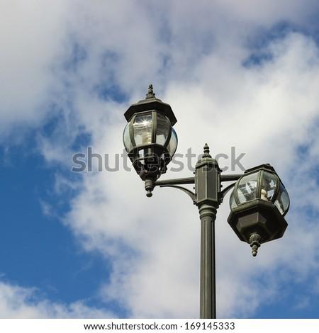 Broken street lamp - stock photo