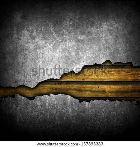 broken wall with wooden planks  - stock photo