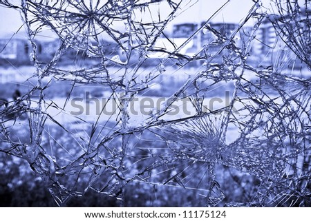 Broken window, dark blue toned. - stock photo