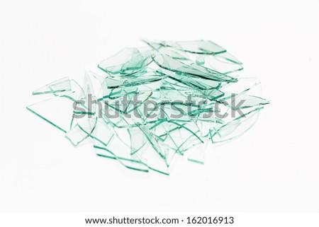 Broken window glas heap on white gray background - stock photo