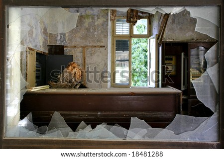 Broken window in an abandoned hotel after the war in Croatia - stock photo