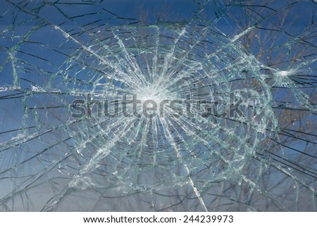 Broken Window with blue sky background. - stock photo