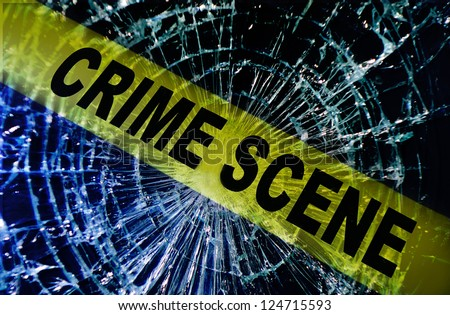 Broken window with yellow Crime Scene tape - stock photo