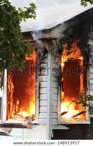 Broken windows are a flash point for house fires - stock photo