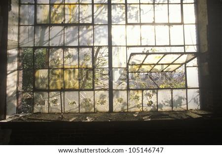 Broken windows in abandoned factory, East St. Louis, Missouri - stock photo