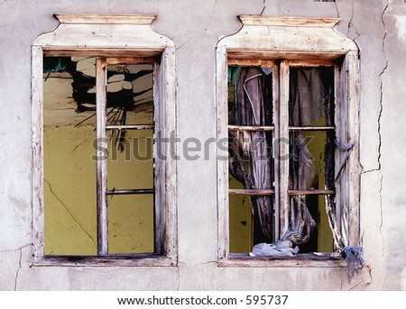 Broken windows - Who lives there? - stock photo