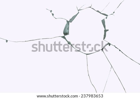 Broken windshield glass on a grayish background - stock photo