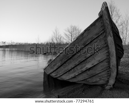 Broken wooden-boat at the beach - stock photo