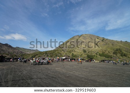 BROMO, INDONESIA - 2ND MARCH 2014; Tourists start gathering for climbing the slopes of Mount Bromo on March, 2 2014. The active Mount Bromo is one of the most visited tourist attractions in Indonesia, - stock photo