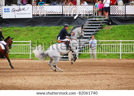 BROMONT-CANADA JULY 30: Unknown rider on a horse during 2011, INTERNATIONAL BROMONT on July 30 2010 At the Equestrian 1976 Montreal Olympic Park. - stock photo