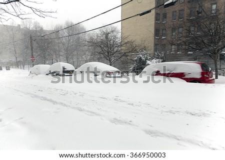BRONX, NEW YORK - JANUARY 23: Blizzard storm Jonas buries cars in snow on Woodycrest avenue.  Taken January 23, 2016, in the Bronx,  New York. - stock photo
