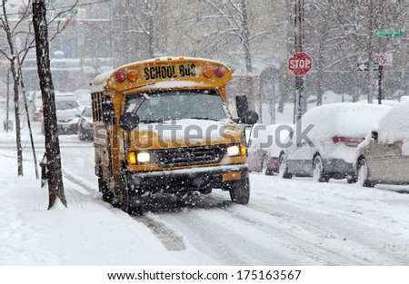 BRONX, NEW YORK - JANUARY 21: School bus during a 6 to 10 inch snow storm with teen temperatures along Ogden avenue and 162nd street.  Taken January  21,  2014 in the Bronx,  New York. - stock photo