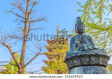 bronze buddha statue at senso-ji temple, asakusa, tokyo, japan - stock photo