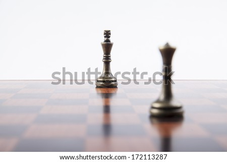 Bronze Chess Set Pieces King and Queen with Focus on King - stock photo