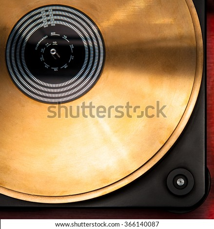 Bronze disc of hi-end turntable record player close up top view - stock photo
