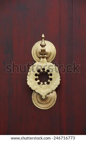 Bronze door knob with Arabian pattern - stock photo